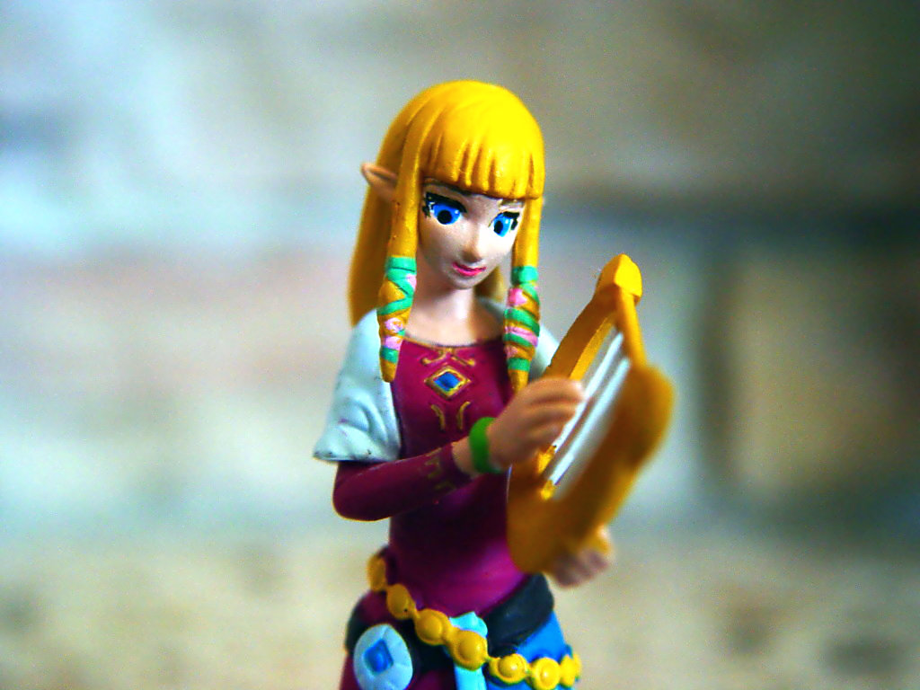 blond_hair elf instrument bracelet princess pink_dress belts gashapon long_hair blue_eyes capsule_toy shawl straight_bangs trading_figure braided_hair takara_tomy_a.r.t.s the_legend_of_zelda princess_zelda the_legend_of_zelda:_skyward_sword
