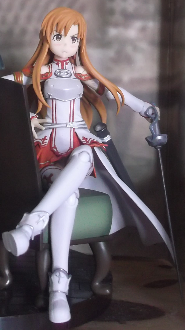 figma sitting brown_eyes chair scabbard rapier armour sitting_pose red_skirt long_hair sword max_factory asuna hand_on_hip white_armor pouting asai_(apsy)_masaki sword_art_online light_brown_hair sitting_on_chair