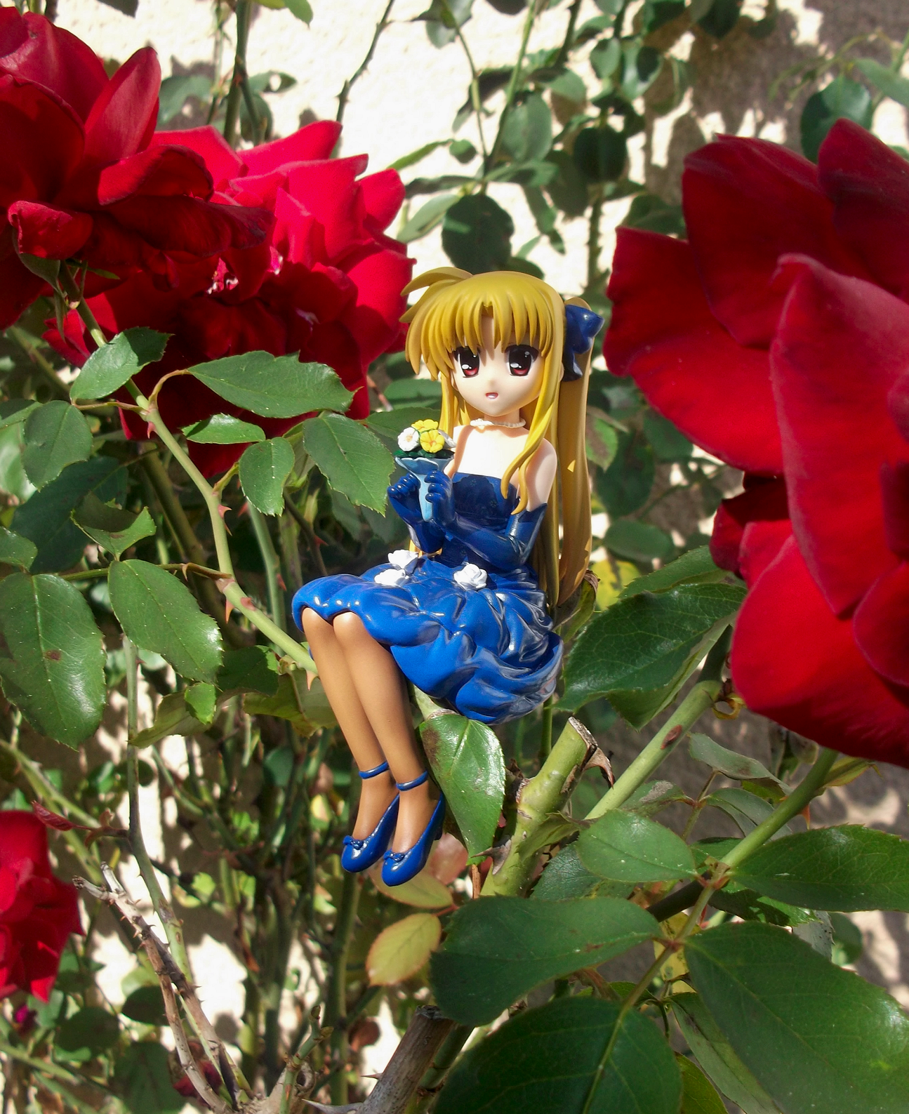 blond_hair ribbon red_eyes dress sitting necklace high_heels flowers rose kotobukiya elbow_gloves tights blue_dress bouquet blue_gloves sitting_pose roses gloves blue_ribbon fate_testarossa branch mahou_shoujo_lyrical_nanoha_the_movie_1st murakami_haruhi hair_ribbons hair_ribbon pearl_necklace blue_high_heels